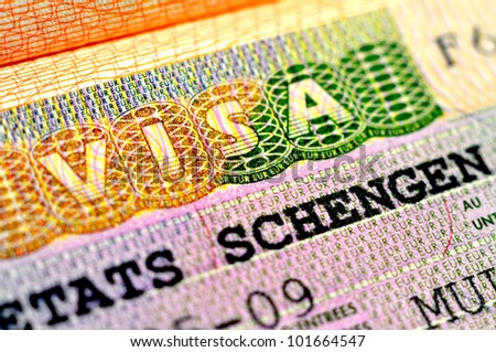 Schengen Visa in passport - stock photo