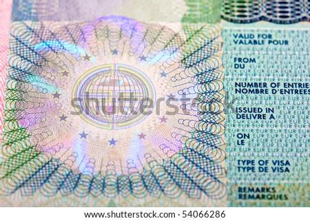 Schengen visa in passport. Fragment - stock photo
