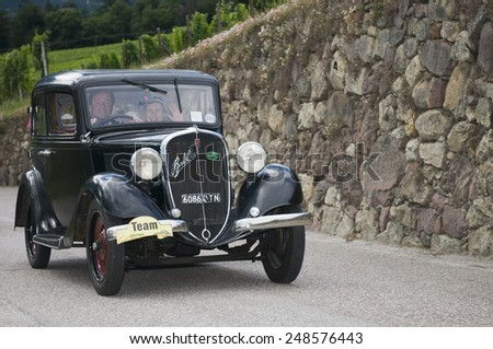 "SCHENNA, ITALY - July 10, 2014: Fiat 508 Balilla (built in 1933) during the 29th public race ""South Tyrol Classic Cars"" on Labers road - stock photo"