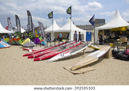 SCHEVENINGEN, HOLLAND - MAY 20: Kite surf camp with surfboards on the beach at the World Cup Kite Surfing in Scheveningen, Holland on May 20, 2012. - stock photo