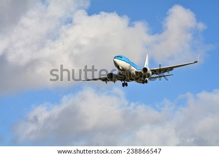 SCHIPHOL, NETHERLANDS - February 16, 2014: KLM or Royal Dutch Airlines in English is the flag carrier airline of the Netherlands.  - stock photo