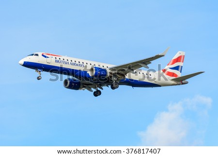 Schiphol, Noord-Holland/Netherlands -February 11-02-2016 -Plane from BA CityFlyer G-LCYM Embraer ERJ-190 is preparing for landing at Schiphol airport. Blue cloudy sky at the background of the airplane - stock photo