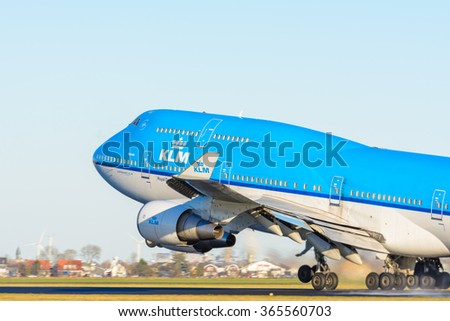 Schiphol, Noord-Holland/Netherlands - January 17-01-2016 - Airplane from KLM Royal Dutch Airlines PH-BFN Boeing 747-400 is taking off at Schiphol airport. The plane will fly to his final destination. - stock photo