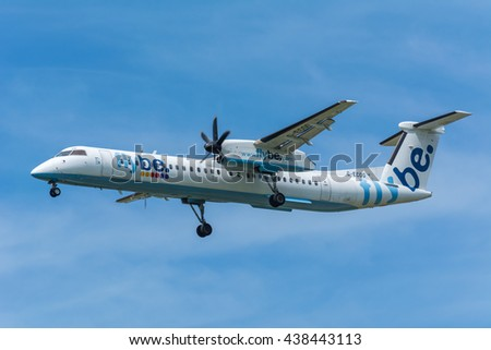 Schiphol, Noord-Holland/Netherlands - June 16-06-2016 - Airplane Flybe G-ECOG De Havilland Canada DHC-8-400 is flying to the airport runway. The Commercial jet started landing gear system for landing. - stock photo