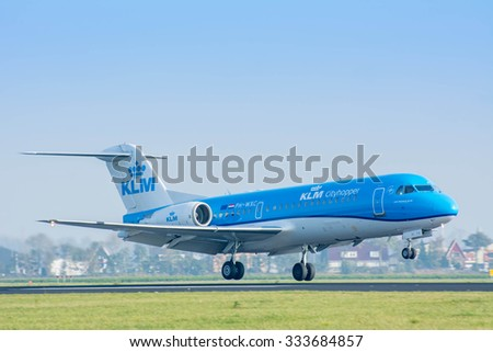 Schiphol, Noord-Holland/Netherlands- October 31-10-2015 -Plane from KLM Cityhopper PH-WXC	Fokker F70 is started landed at Schiphol Airport. Photo taken during daylight, typical aviation background.  - stock photo