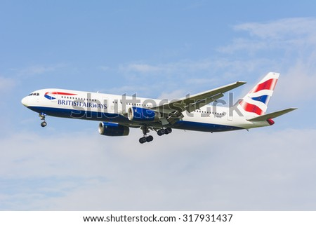 Schiphol, Noord-Holland/Netherlands - September 18-09-2015 - Plane from British Airways G-BZHB  is preparing for landing at Schiphol airport. Blue cloudy sky at the background of the airplane. - stock photo