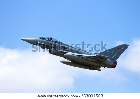 SCHLESWIG,  GERMANY - JUN 23, 2014: German Air Force Eurofighter Typhoon taking off  during the NATO Tiger Meet at Schleswig-Jagel airbase. The event is to promote solidarity between NATO air forces - stock photo