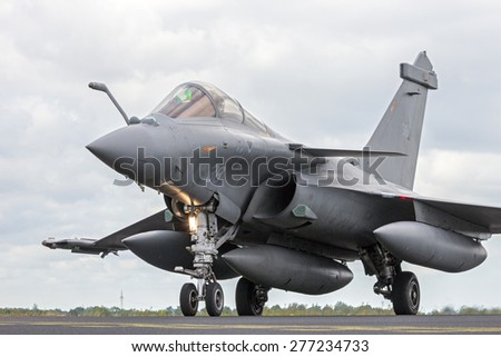 SCHLESWIG-JAGEL, GERMANY - JUN 23, 2014: French Air Force Dassault Rafale during the NATO Tiger Meet at Schleswig-Jagel airbase. The Tiger Meet is to promote solidarity between NATO air forces - stock photo