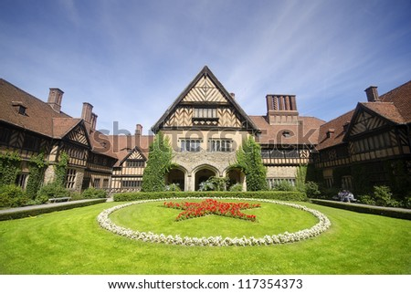 Schloss Cecilienhof is a palace located in Neuer Garten (Potsdam), where the Potsdam Conference took place in 1945 - stock photo