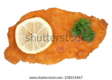 Schnitzel chop cutlet with lemon from above isolated on a white background - stock photo