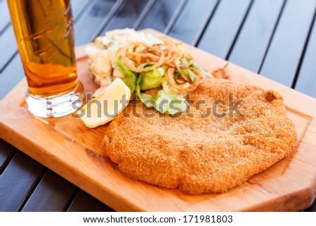 Schnitzel with salad - stock photo