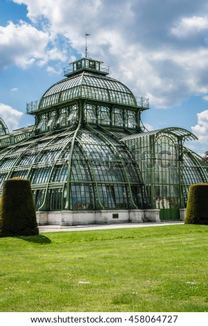 Schoenbrunn palace - former imperial summer residence, built and remodelled during reign of Empress Maria Theresa from 1743. Palm House in former Dutch Garden, was erected in 1881. Vienna, Austria. - stock photo