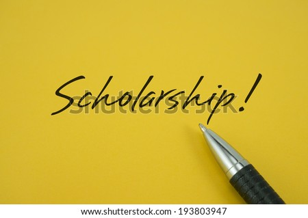 Scholarship! note with pen on yellow background - stock photo
