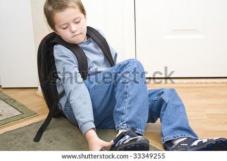 School age boy getting dressed & ready for school - stock photo