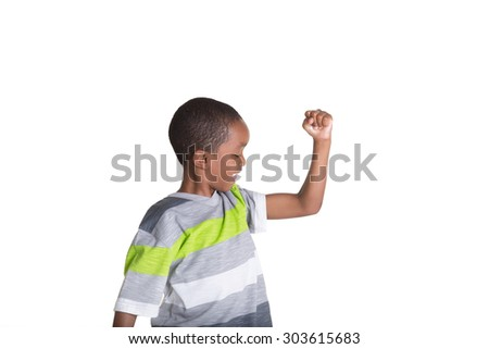 School aged child showing off his muscles - stock photo