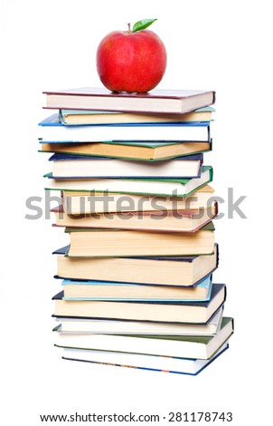 School and Education. Books tower with apple isolated on white - stock photo