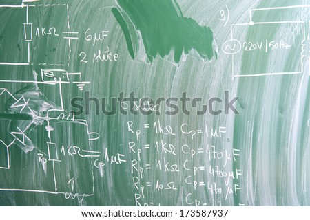 School blackboard with physics formulas - stock photo