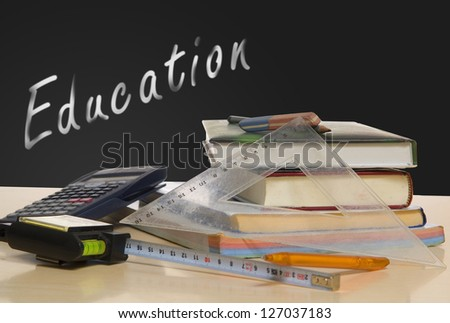 School books on desk with education text in back - stock photo