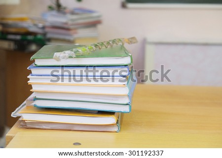 School books on the table - stock photo
