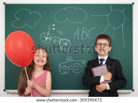 school boy and girl drawing on board - stock photo