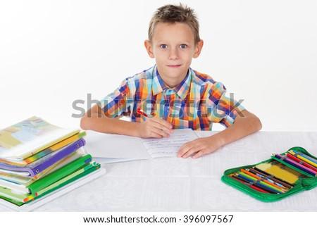 School boy is doing his homework - stock photo