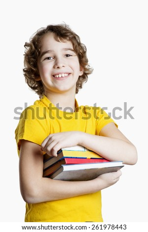 School boy is holding books isolated on white background - stock photo