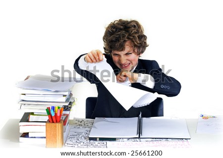 school boy ripping up his work - stock photo