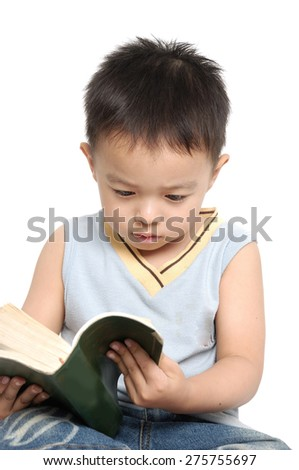 School boy sitting floor and writing in book.  - stock photo