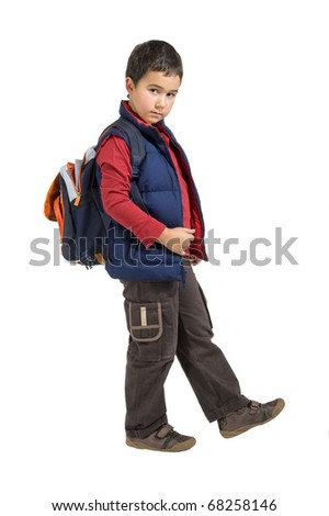 school boy standing with his backpack - stock photo