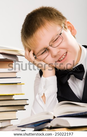School boy tired of learning process - stock photo