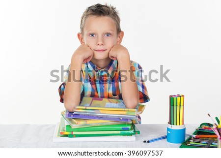 School boy with pile of books - stock photo
