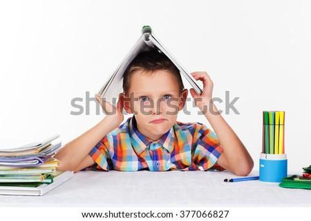 School boy with unhappy face  - stock photo