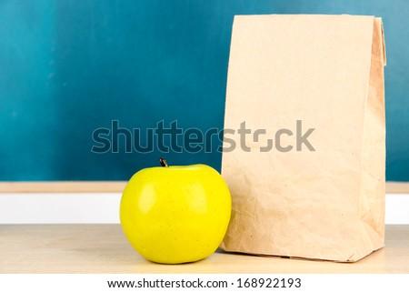 School breakfast on desk on  board background - stock photo