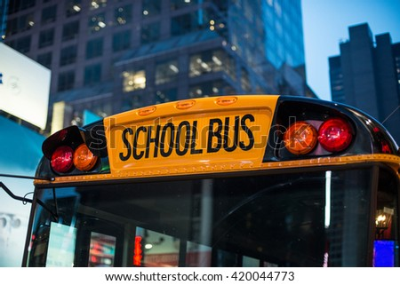 School bus children educational transport sitting in the parking at the night  in New York City street - stock photo