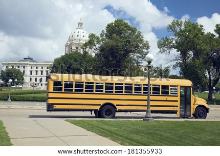 School Bus in front of State Capitol in St. Paul. - stock photo