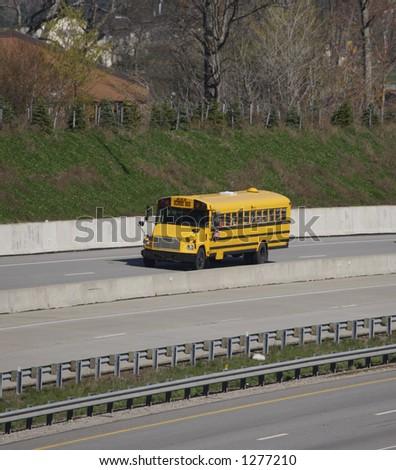 School Bus on the highway - stock photo