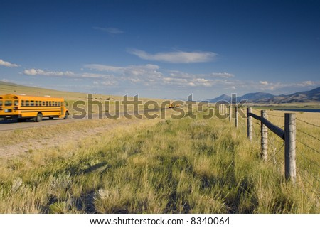 School bus on the road of the West. - stock photo
