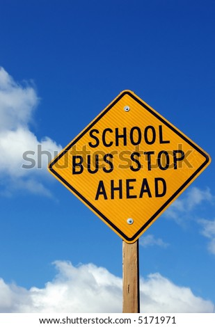 School bus stop ahead sign with cloudy sky background - stock photo