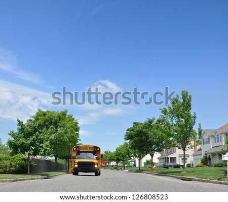 School Bus Suburban Neighborhood Street Stop Sign Flashing Lights - stock photo