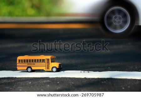 School bus toy model. - stock photo