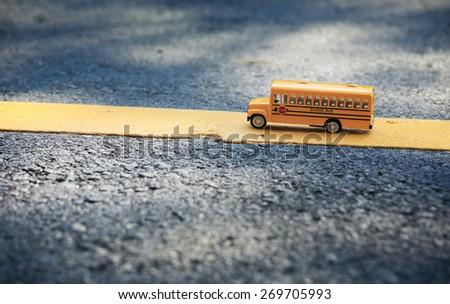 School bus toy model,retro color style. - stock photo