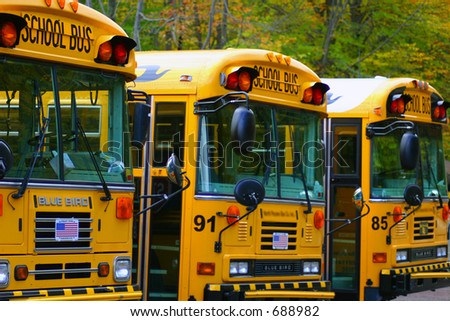 School Buses lined up in a Row, Back to School - stock photo