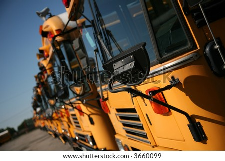 School buses ready to roll - stock photo
