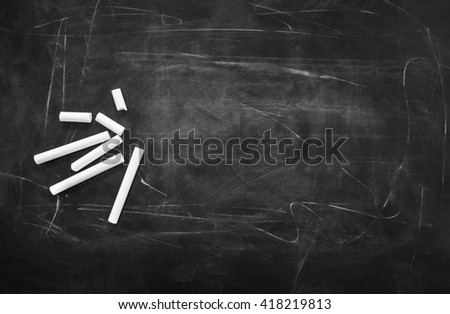 school chalkboard with chalk and space for text - stock photo