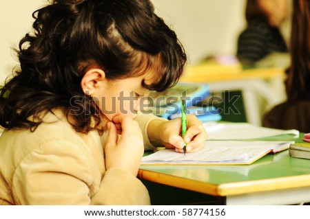 school child in classroom, cute girl - stock photo