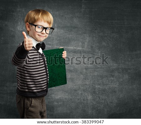 School Child in Glasses Thumbs Up, Kid Boy Hold Book Certificate, Successful Education - stock photo