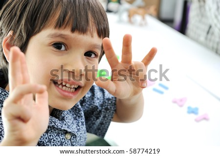 school children, counting on fingers - stock photo