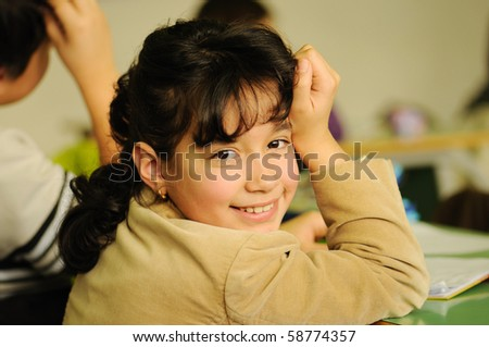 school children, girl in classroom - stock photo