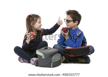 school children having their lunch on white isolated background - stock photo