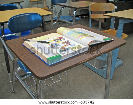 School Desk with Textbook - stock photo